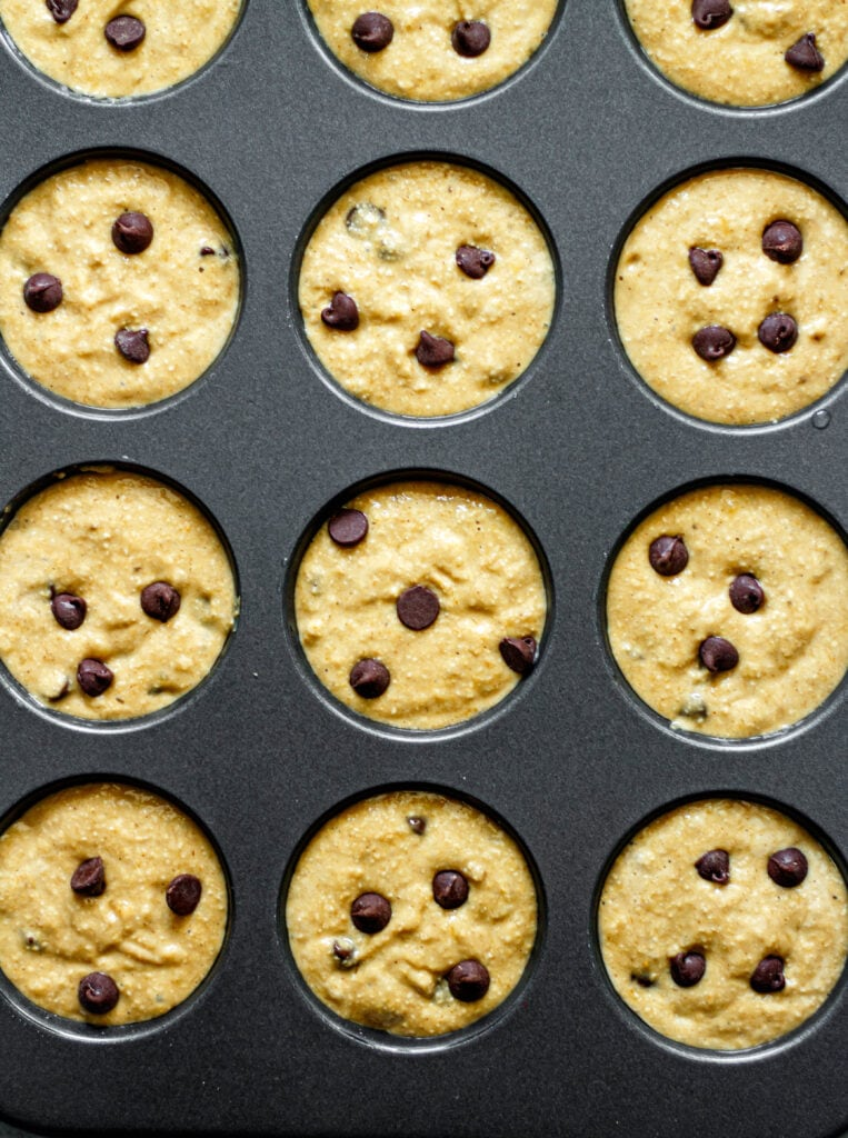 banana chocolate chip muffin batter in muffin tin