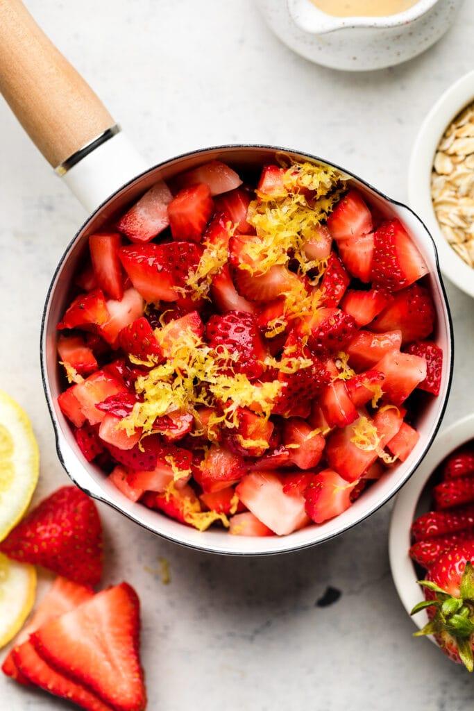 strawberries and lemon zest in bowl