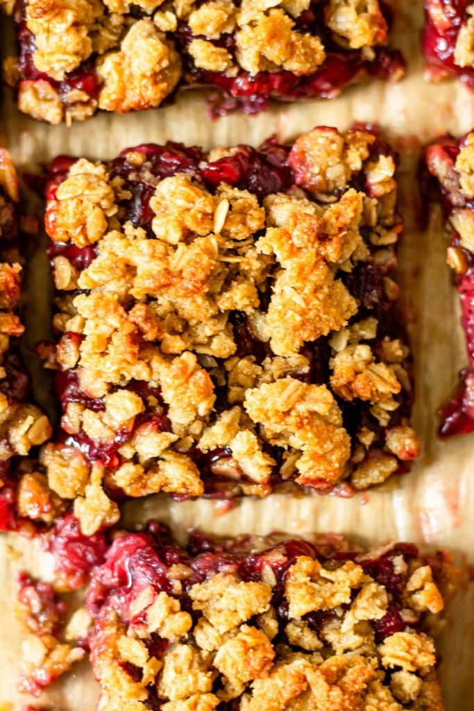 strawberry oatmeal bar on brown parchment paper