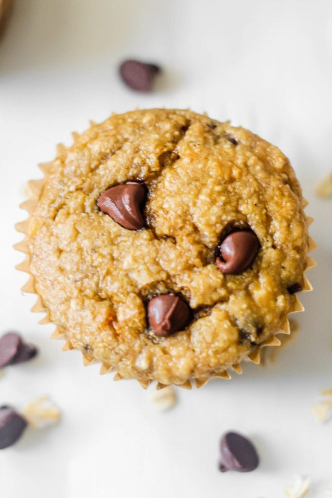banana chocolate chip muffin on white background