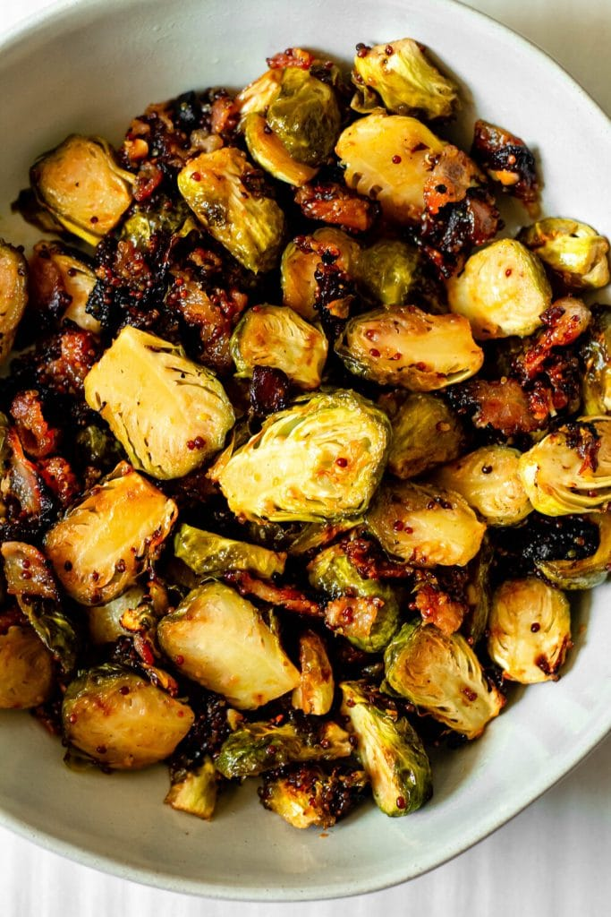 Roasted Brussels sprouts in a white bowl