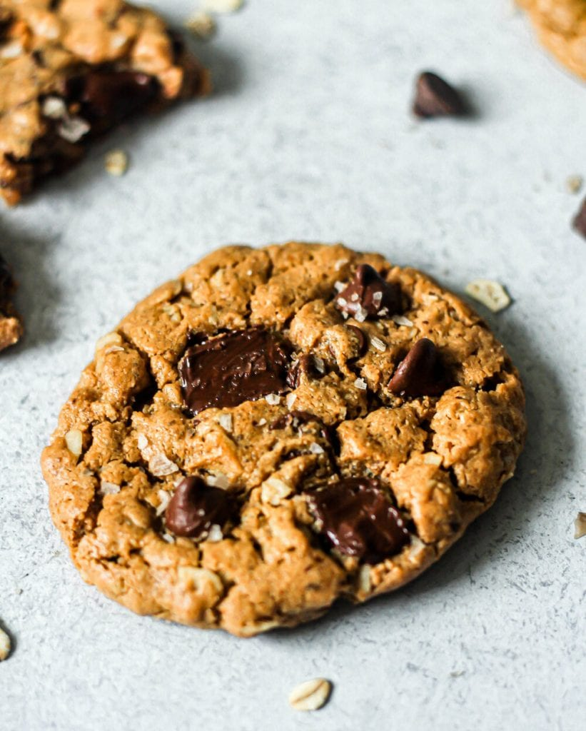 gluten free oatmeal chocolate chip cookie on a marble board