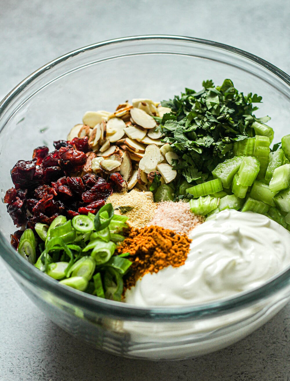 Curry Chicken Salad ingredients in glass mixing bowl