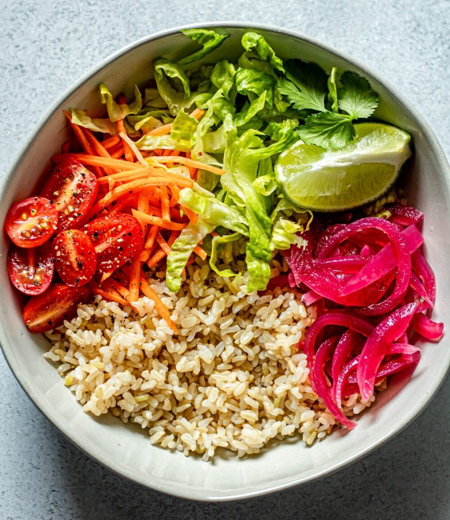 veggies and brown rice in white bowl
