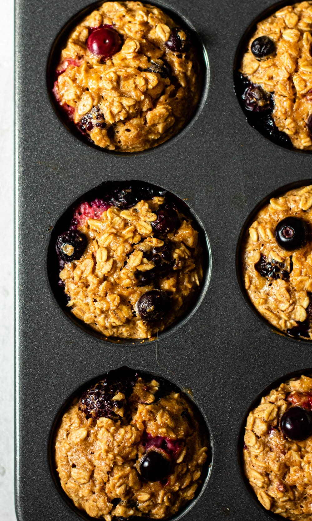 Triple Berry Baked Oatmeal Cups in a muffin pan