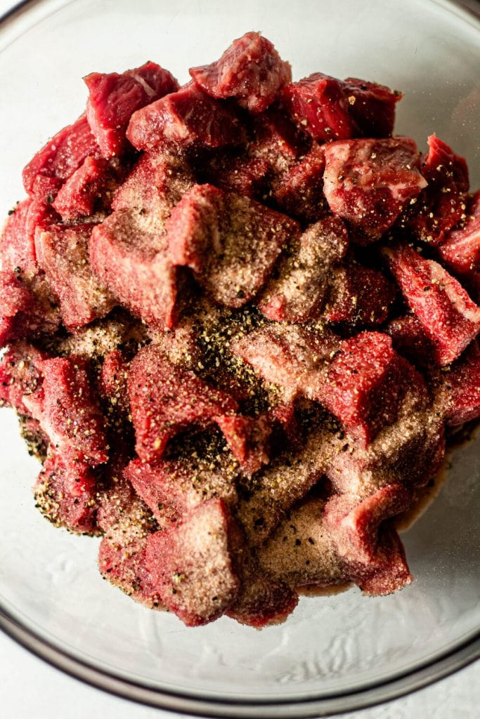 raw steak seasoned with salt and pepper
