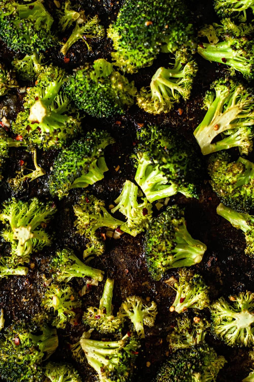 Roasted Garlic Lemon Broccoli on brown sheet pan