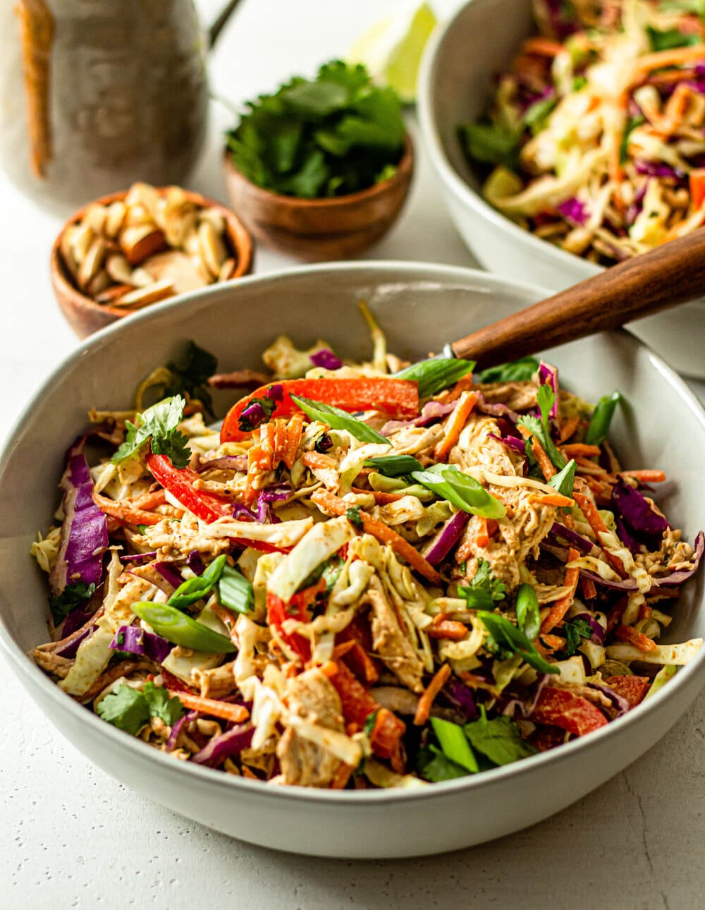 Chopped Thai Chicken Salad in white bowl with brown fork