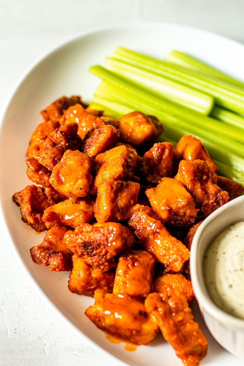 Easy Buffalo Chicken Bites with celery and ranch