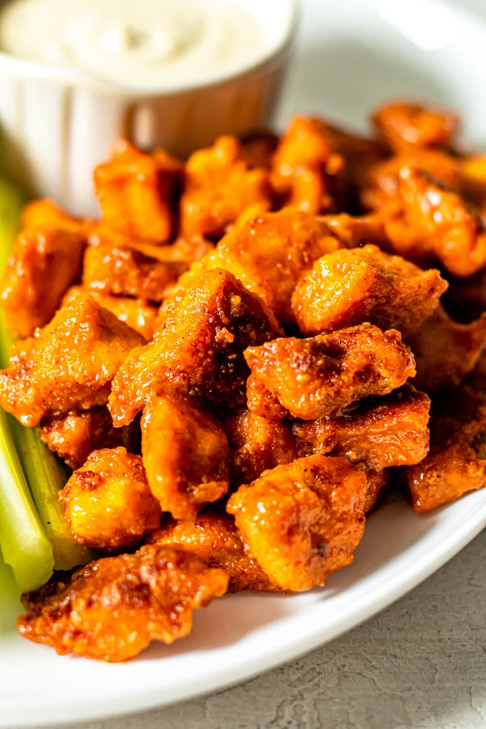 Easy Buffalo Chicken Bites on a white plate with celery