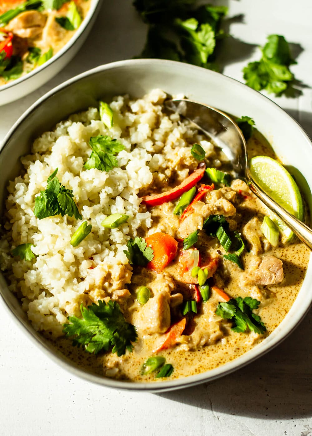 Thai Green Curry with Chicken and Vegetables in white bowl