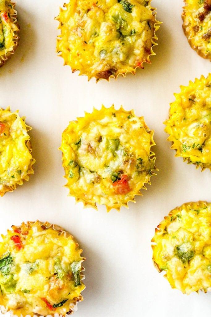 loaded breakfast egg muffins on white background