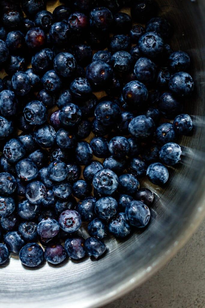 fresh blueberries in silver skillet