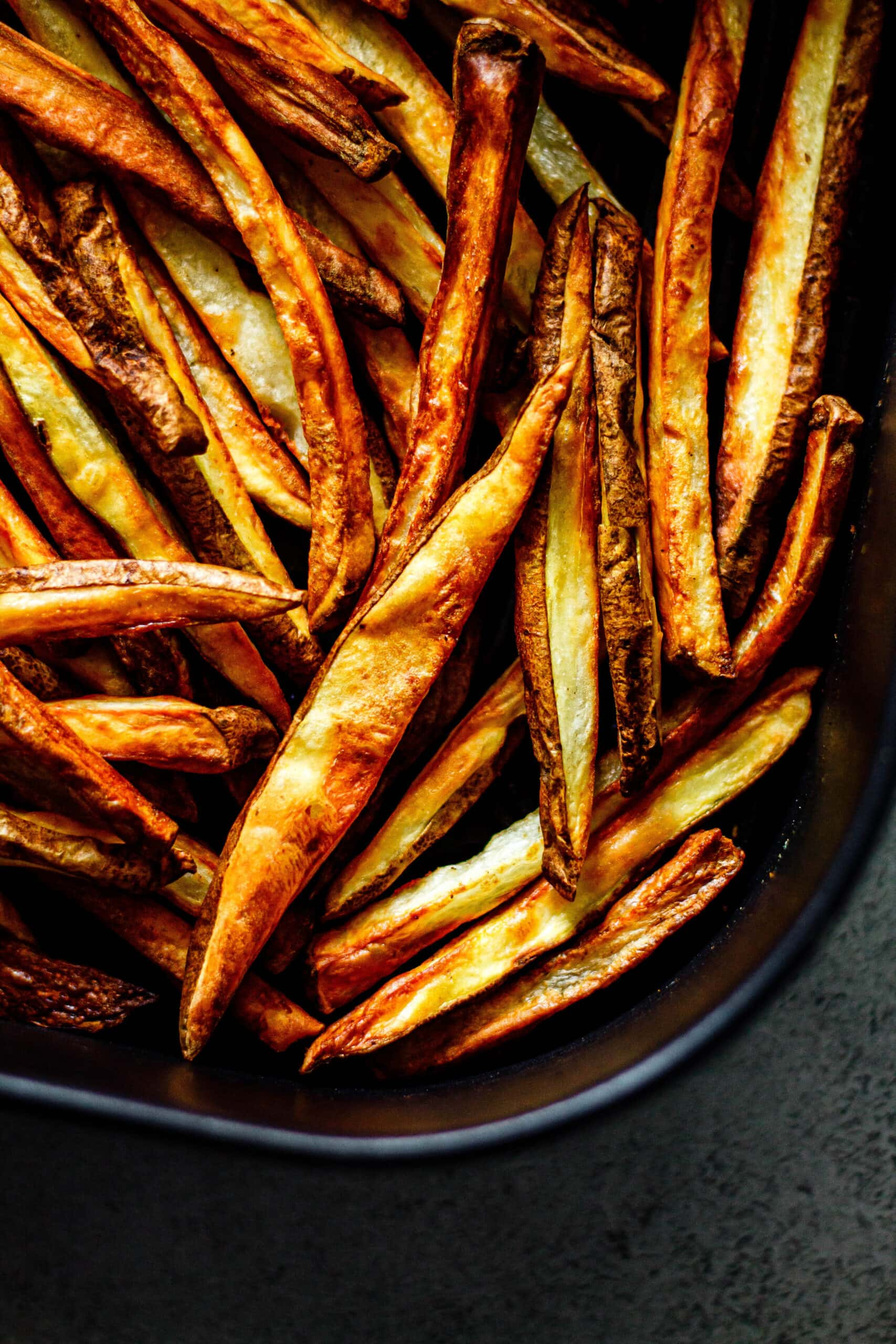 cooked French fries in black air fryer