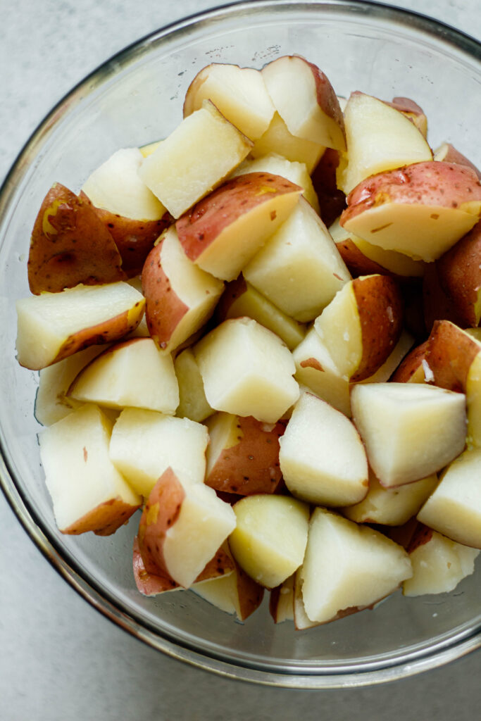 boiled red potatoes in a glass mixing bowl