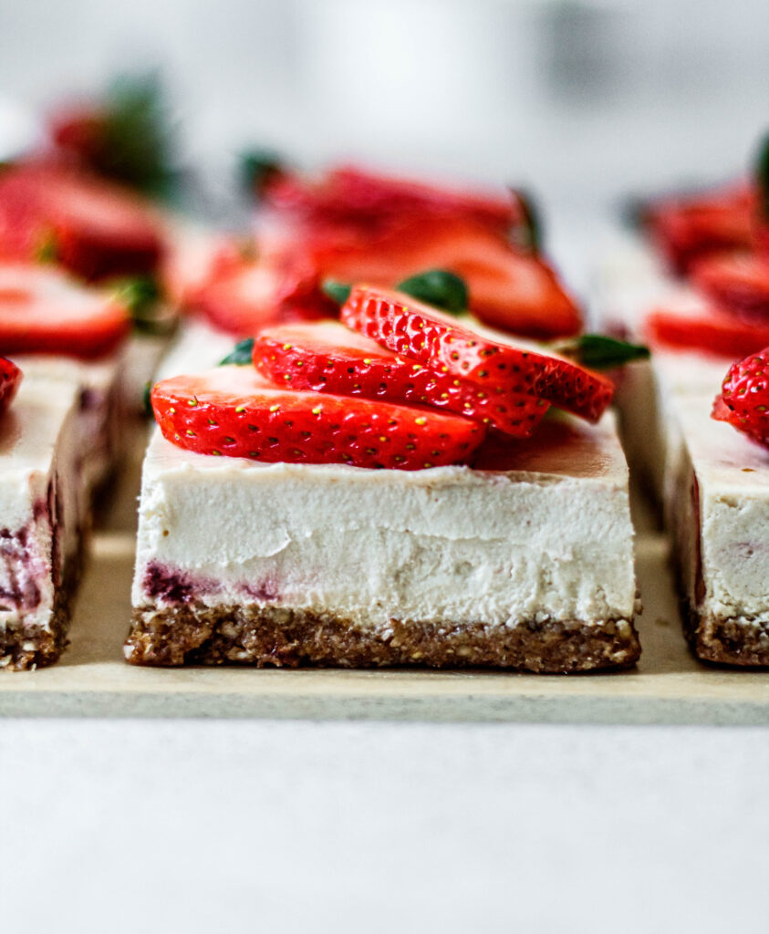 strawberry cheesecake bar topped with strawberries