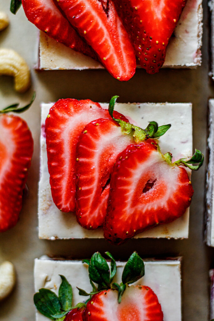 strawberry cheesecake bar topped with fresh strawberries