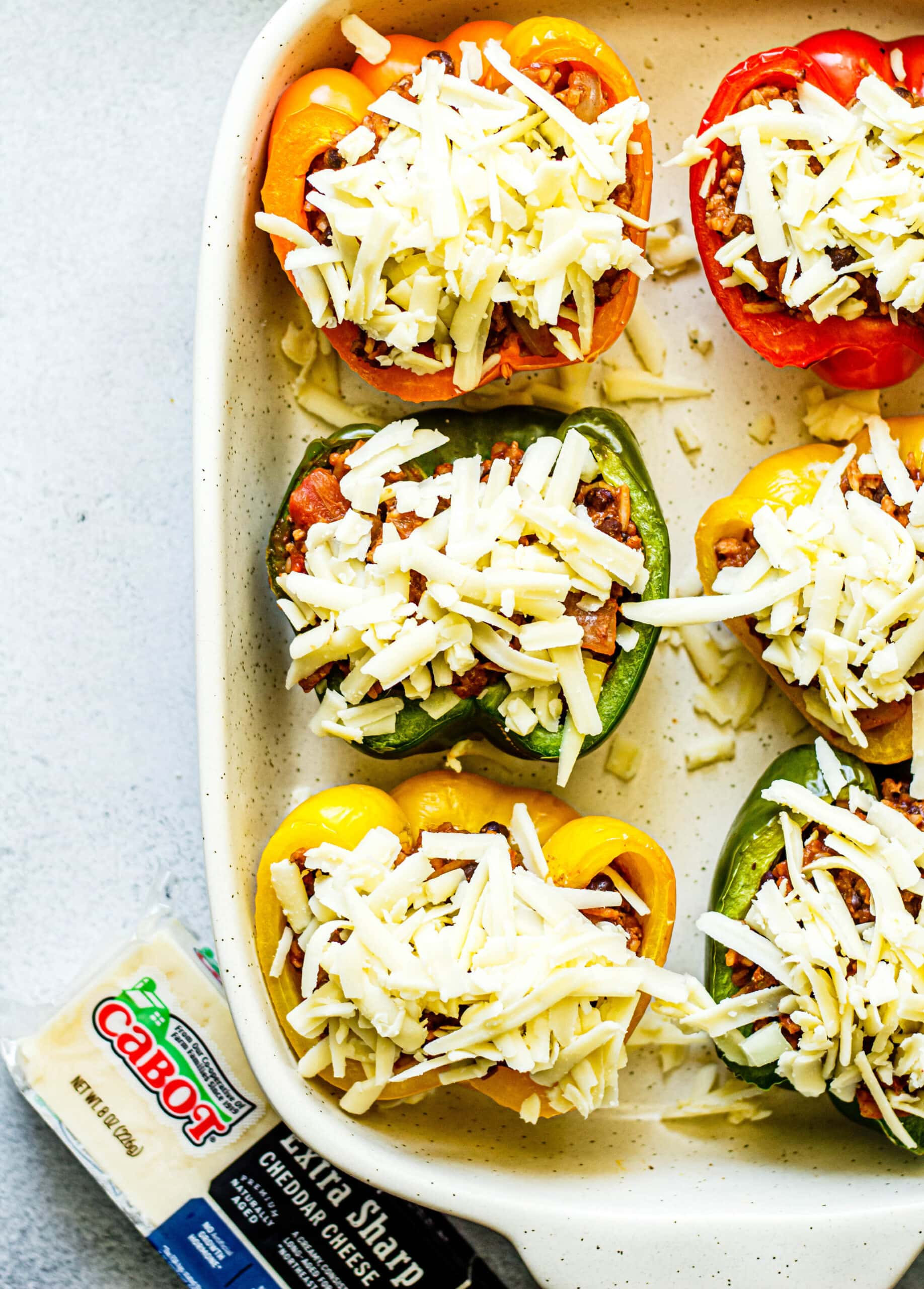 stuffed peppers topped with shredded cheese