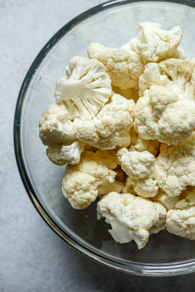 cauliflower florets in a clear mixing bowl