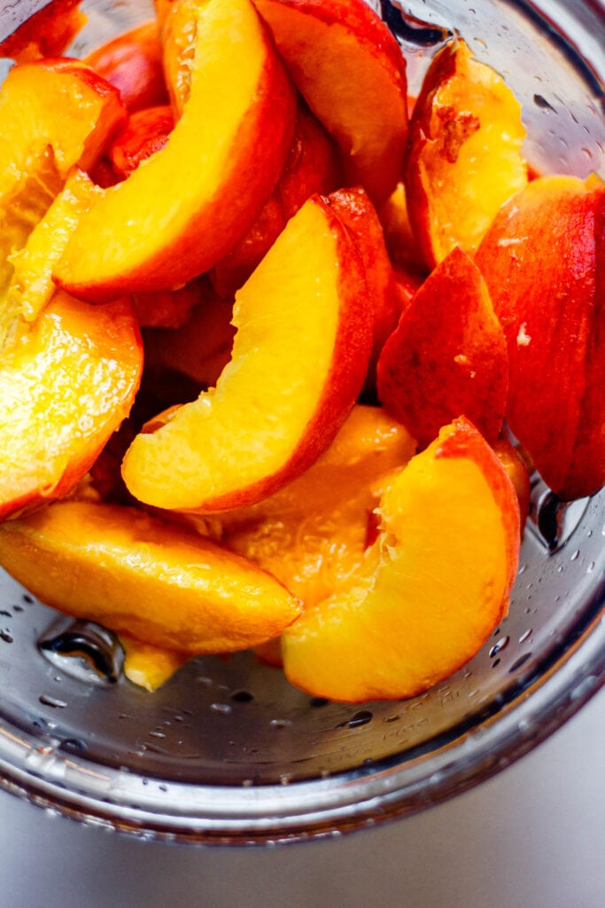 sliced peaches in a blender