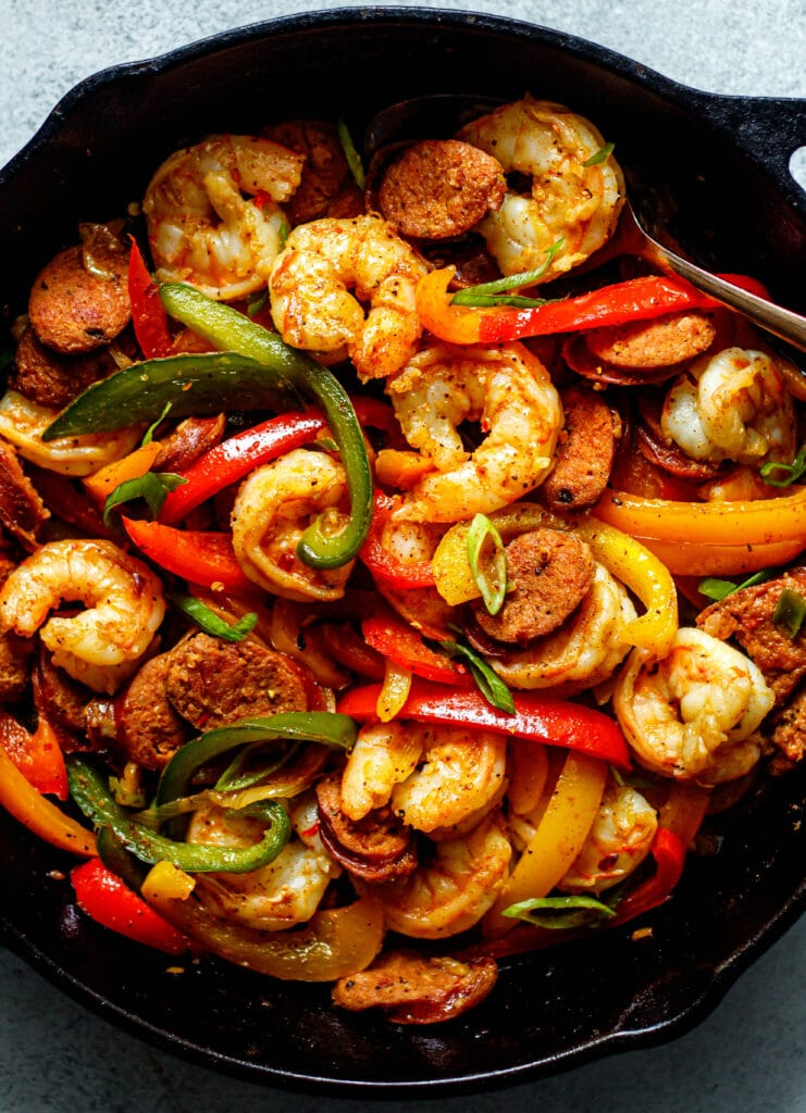 sausage, shrimp, peppers, onion in a cast iron skillet