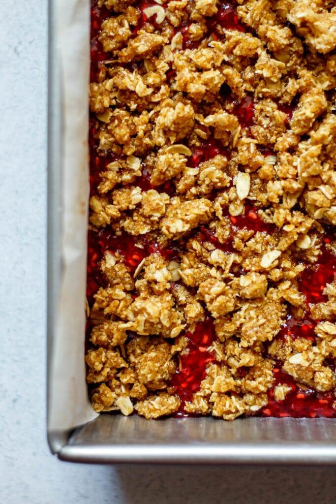 healthy raspberry oatmeal bars before baking in 8x8 pan