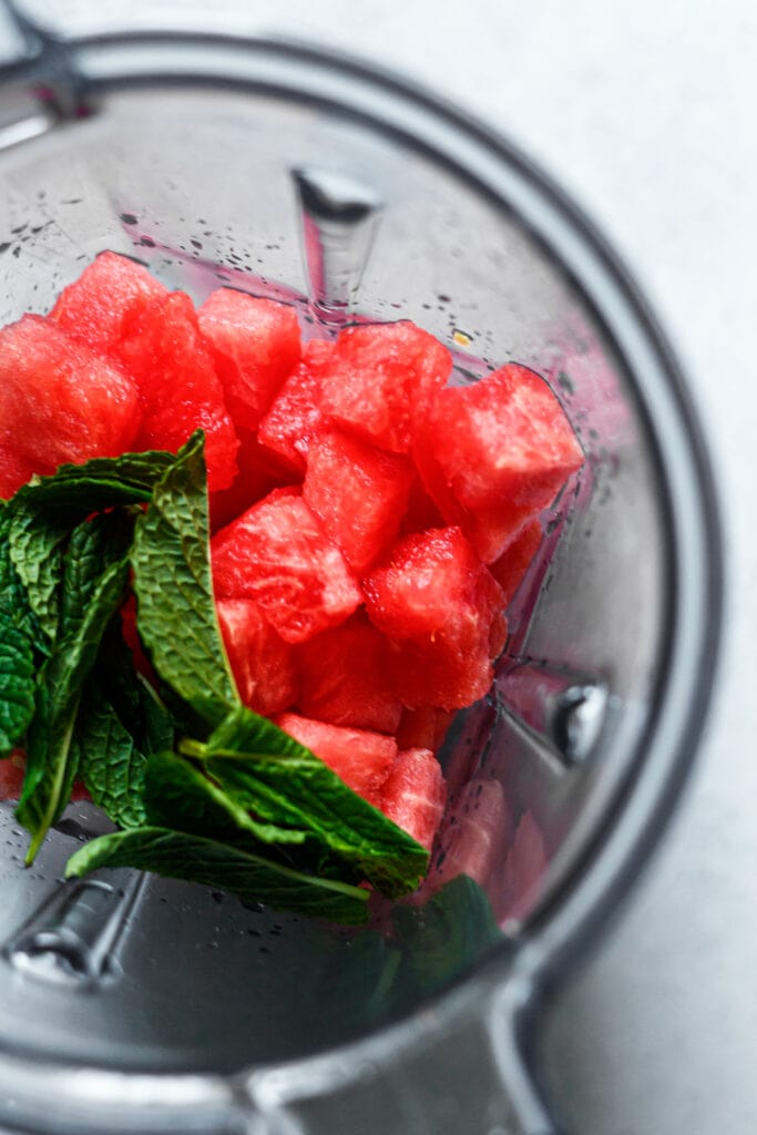 cubed watermelon and mint in a blender