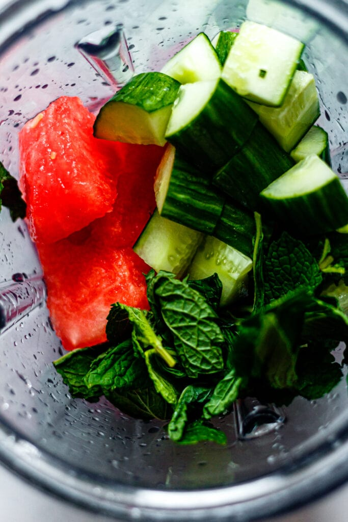 watermelon, cucumber, and mint leaves in a blender