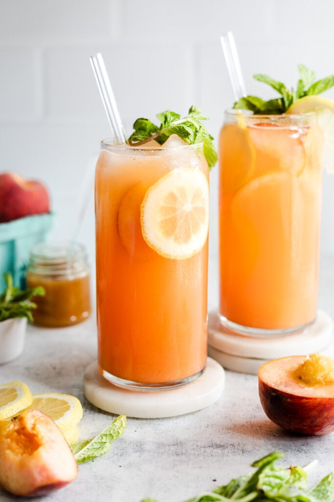 peach lemonades in glasses with straw