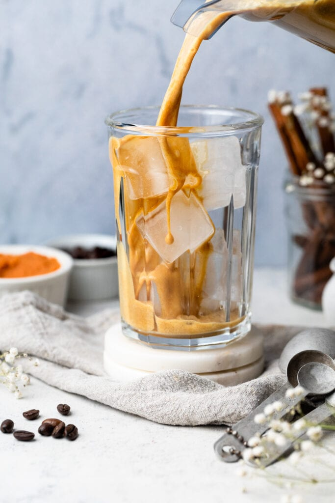 cold brew being poured into glass