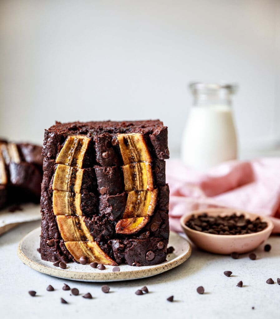slices of banana bread stacked on a plate