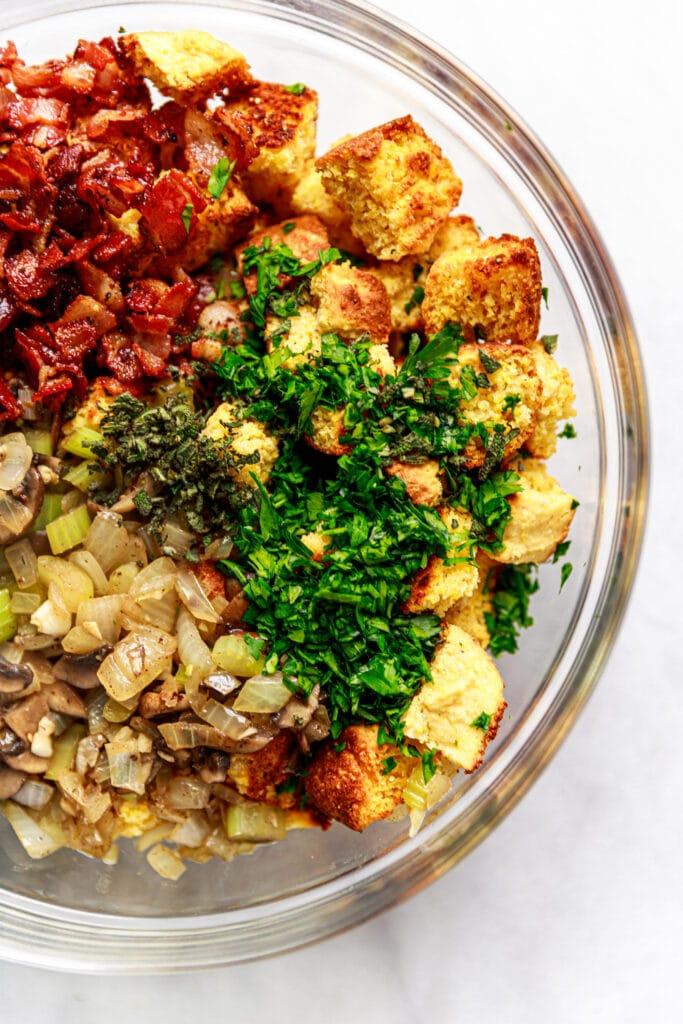 cornbread, veggies, and bacon in bowl