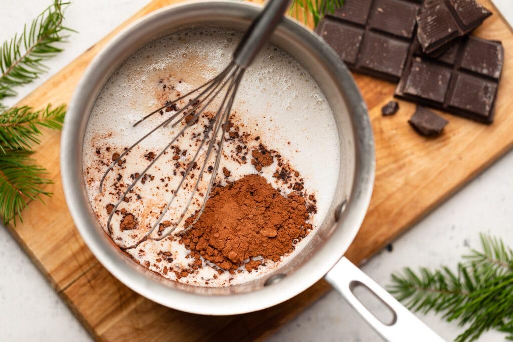 milk in saucepan with cocoa powder