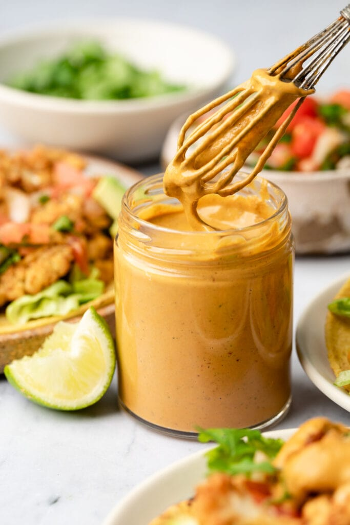 spicy lime tahini in small jar