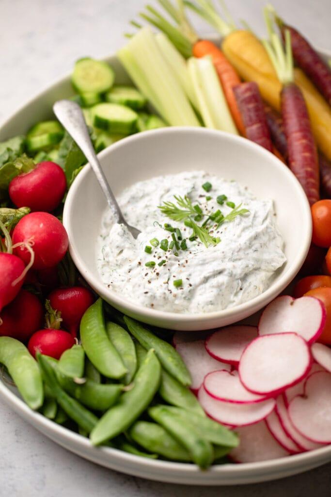 Greek Yogurt ranch dip with spoon and veggies
