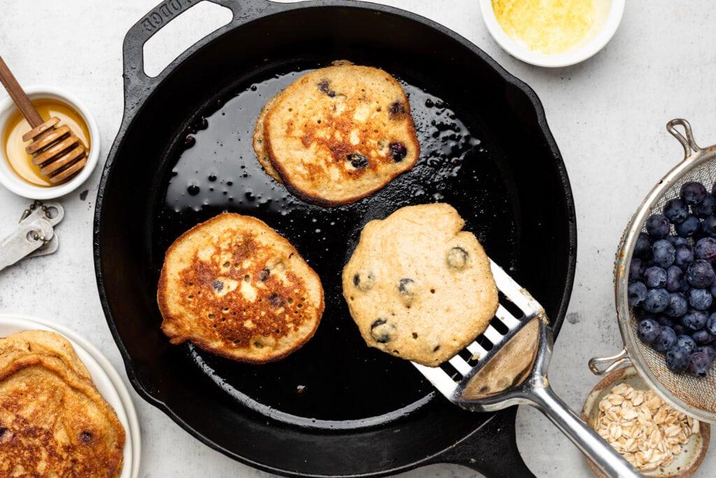 pancake batter in cast iron skillet