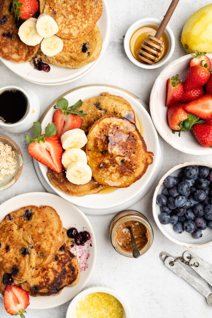 pancakes on plates with toppings