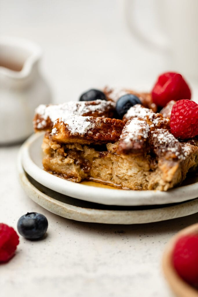slice of French toast casserole with berries on top