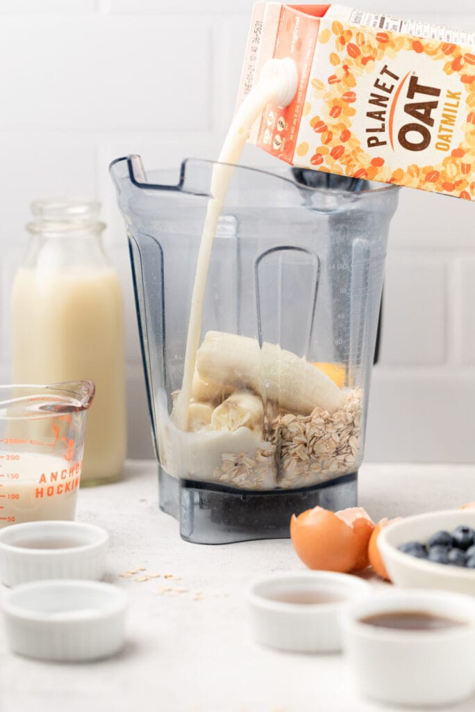 oat milk being poured into blender
