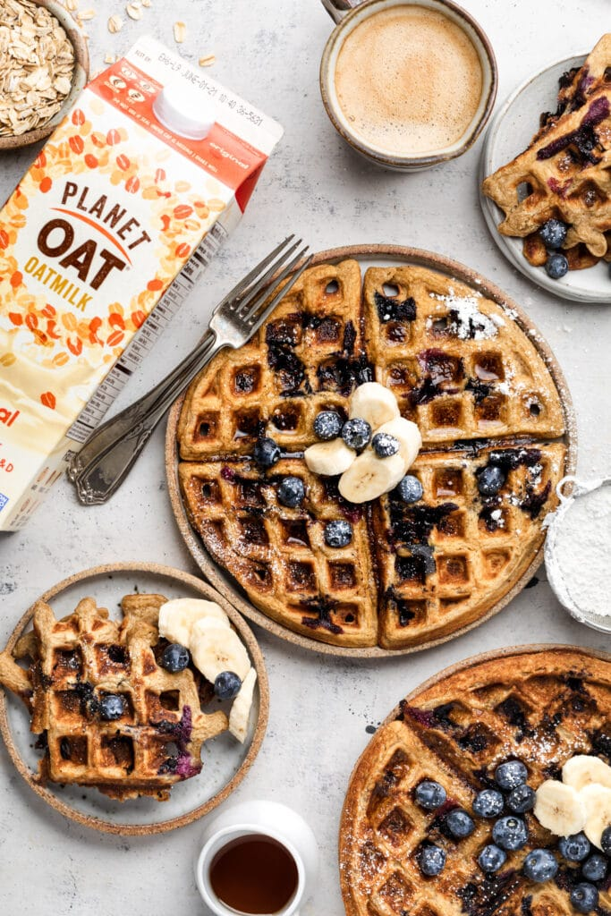 gluten free blueberry waffles on plates with coffee