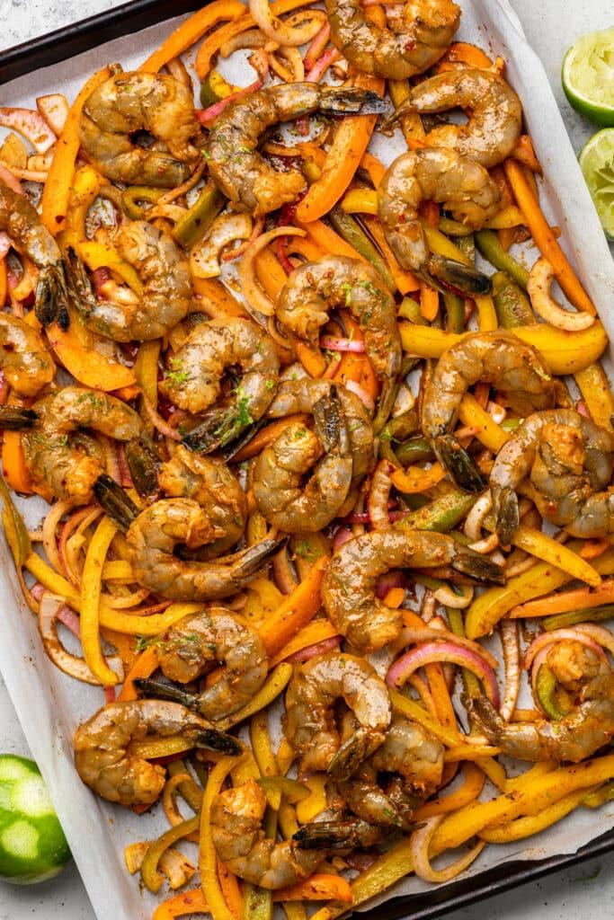 raw shrimp and veggies on sheet pan