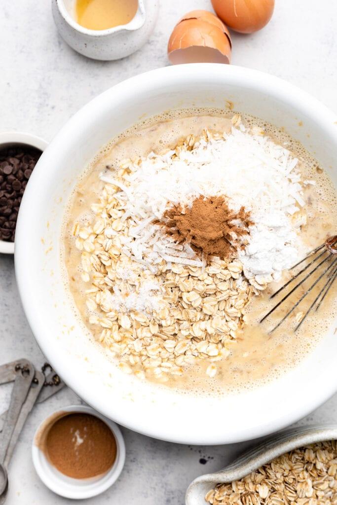 baked oatmeal batter in white bowl