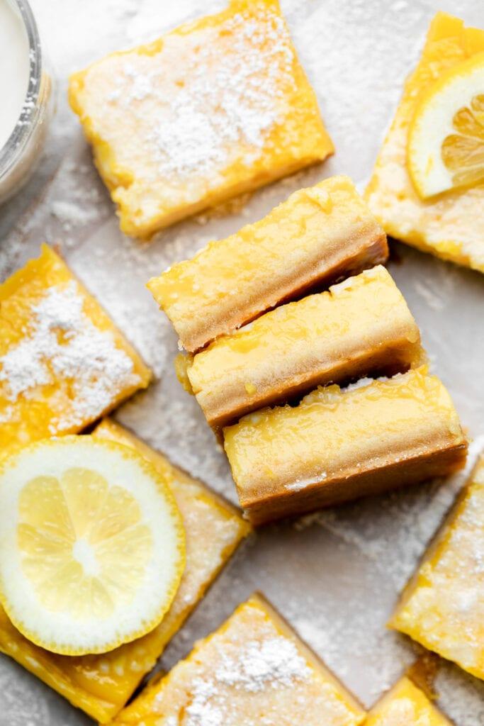 lemon bars on parchment paper