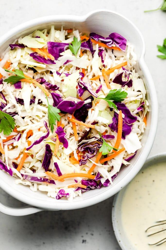 homemade coleslaw in white bowl