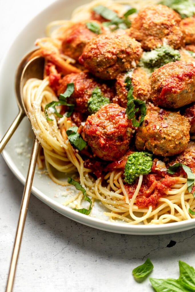 pesto turkey meatballs over pasta