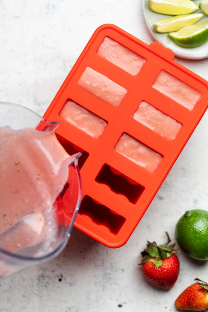 popsicle mixture being poured into mold