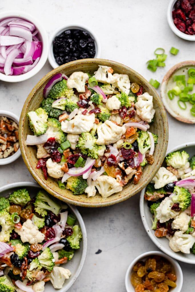 broccoli cauliflower salad in bowls