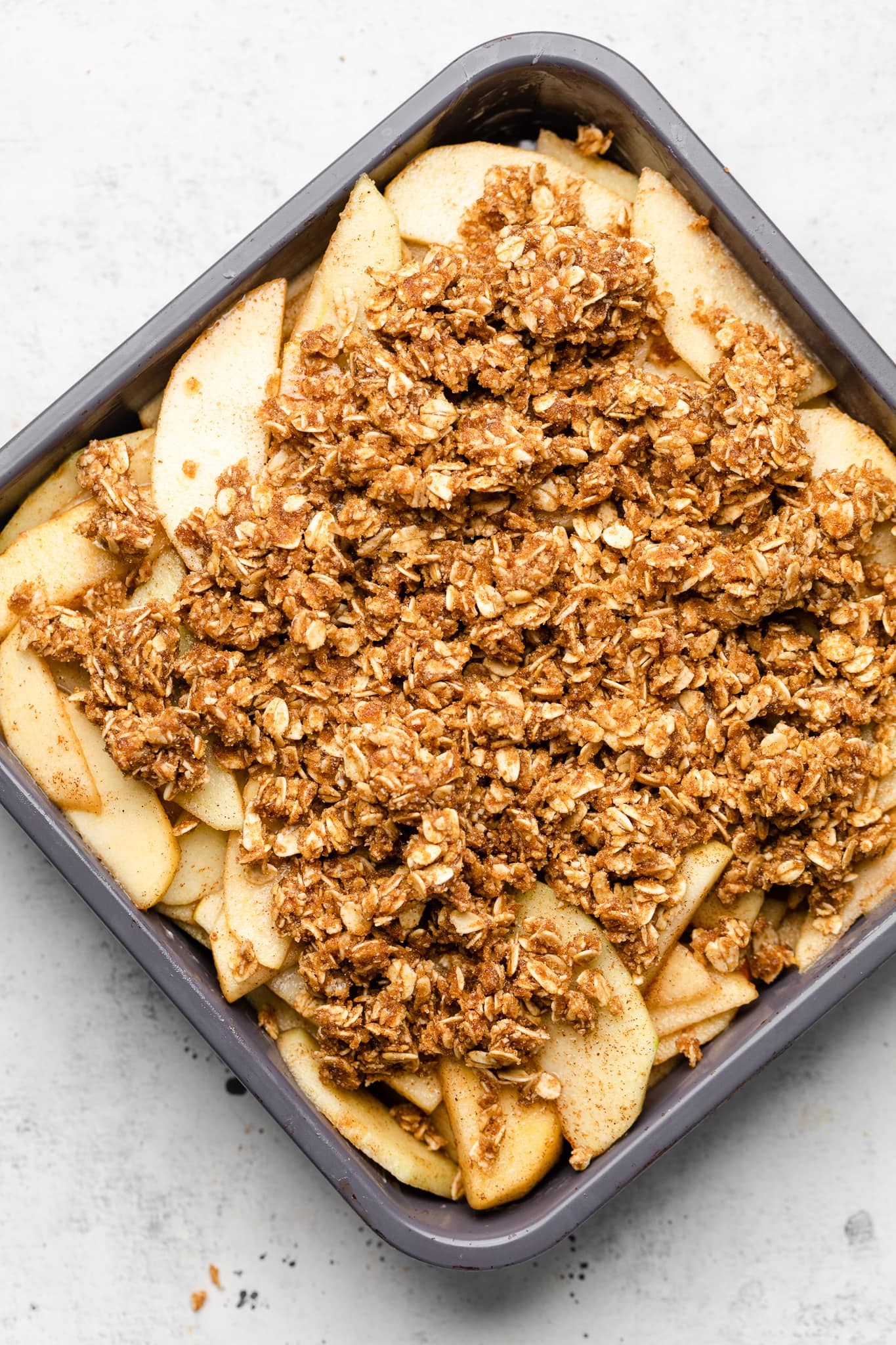 apple filling and apple crisp toping in a baking pan.