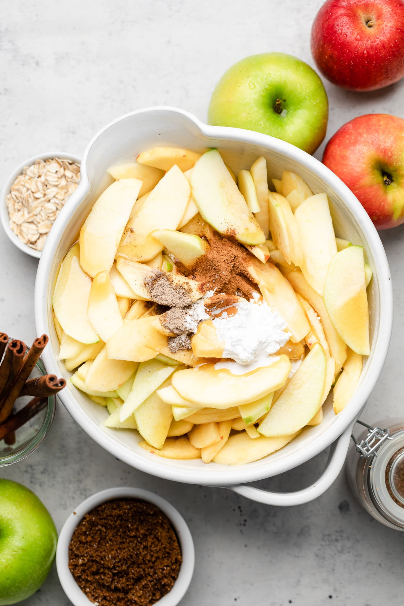 apples in a bowl with cinnamon, caradamom, and cornstarch