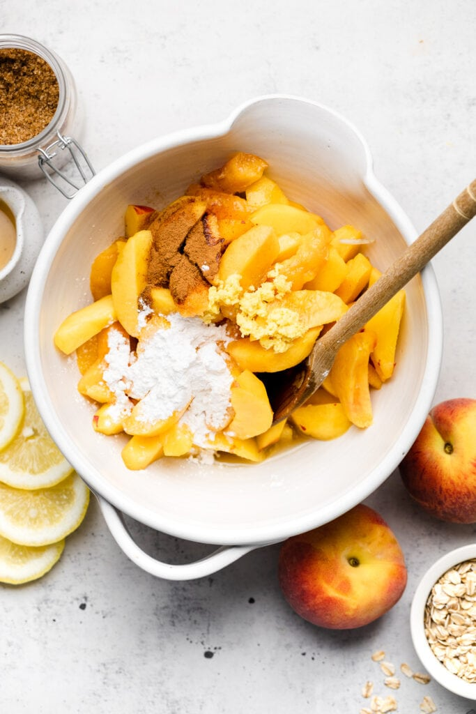 peaches in bowl with cinnamon and arrowroot